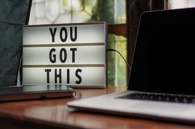 Image of a laptop on a desk with a focused light box saying 'You Got This'